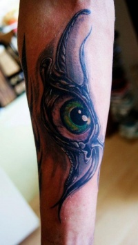 Awesome eye tattoo on arm