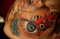 Beautiful colorful eye and butterflies tattoo