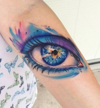 Beautiful watercolor eye  tattoo by Mike Shultz