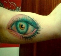 Colorful eye tattoo on arm