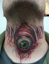 Evil eyeball tattoo on throat healed by graynd