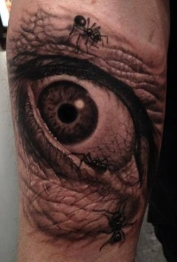 Eye and ants tattoo