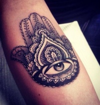 Eye in center of ornament tattoo