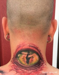 Eyeball tattoo on the back of the neck by graynd