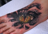 Snake eyes tattoo on the foot by graynd